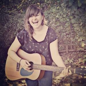 Sophomore Erin Wertz often sings and plays guitar at Open Mic Nights.  Photo credit Sarah Belinga