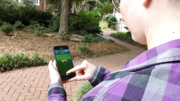 Nicole Heckemeyer playing Pokemon Go on campus